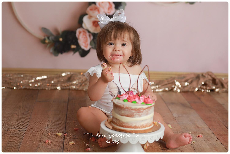 lorigeneroselgphotographygirlcakesmashfirstbirthdaygirlfloralhoopsbackdropcakesmashgirl.jpg