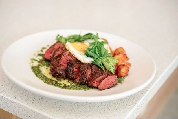 The hanger steak with fried egg and potatos