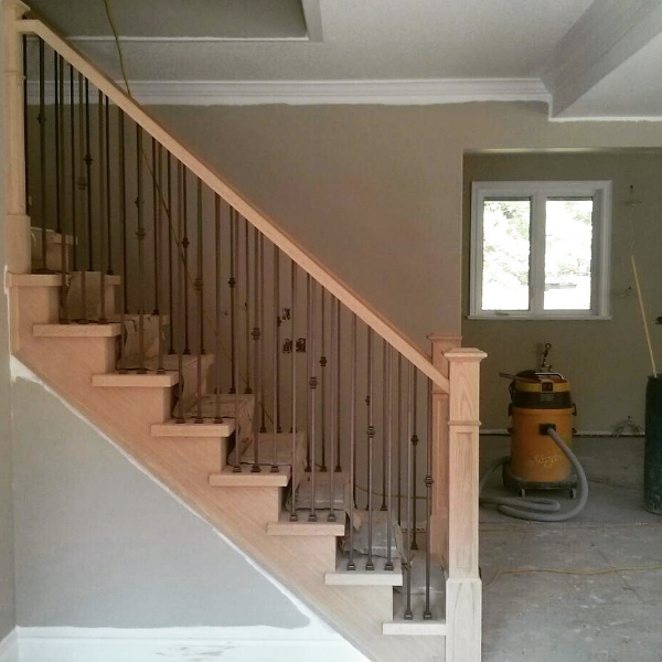 """4-1/2"""" Recessed Panelled Post with Base , TL12-60 & TL130-1-60 Steel Spindles in the Burnt Penny finish.  Job Location: Collingwood"""