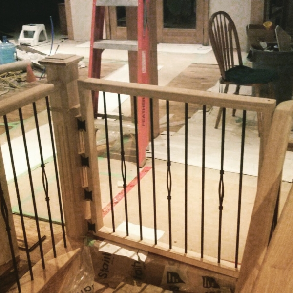 Custom Hickory baby gate which we built to match the existing new railing system we installed.  1-3/4 x 2-3/4 Hickory Standard railing, TL15-40 & TL102-1RD-40 Wrinkled Black spindles.  Job Location: Sudbury, Ontario