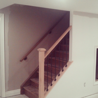 """3-1/2 Chamfered Post with Cap - Oak, 3"""" Colonial Railing, TL12X-30 and TL102X-1-30 Satin Black Spindles  Job Location: Snow Valley, Ontario"""