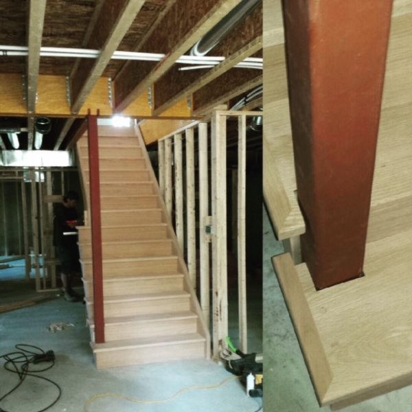 Open Part 1 Side Oak Stairs. We had to build half of this stair on-site and notch it around the steel jack post which will be cladded on a later date. Job Location: Snow Valley, Ontario