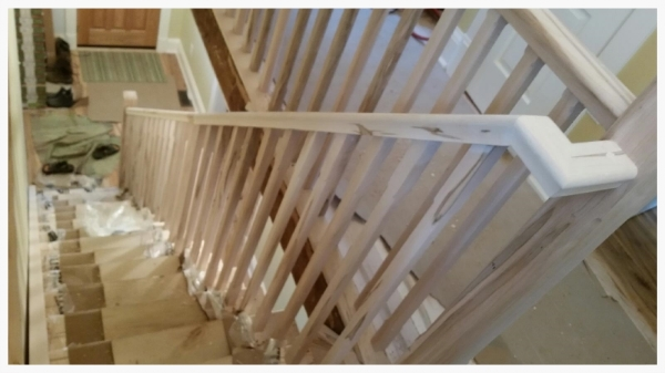 """1-3/4 x 2-3/4 Wormy Maple Standard Railing, 3-1/2 Chamfered Contemporary Wormy Maple Post, 1-5/16"""" Chamfered Wormy Maple Spindles. All materials were milled by hand in our shop.  Job Location: Toronto, Ontario"""