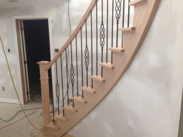 Circular Stair: 3-1/2 Fluted Post with Cap, Standard Oak Railing, TL15RD-40 & TL103-1-40 circular steel spindles.  Job Location: Stayner, On.