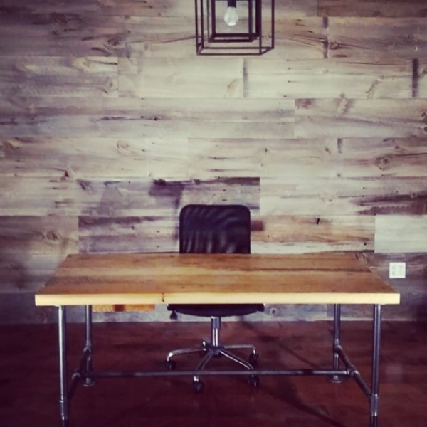 """Custom 2"""" Brown Board Desk with pipe legs. We also made a custom drawer out of the same material. Barn Board feature wall materials supplied by Stairhaus as well.  Job Location: Barrie, On"""