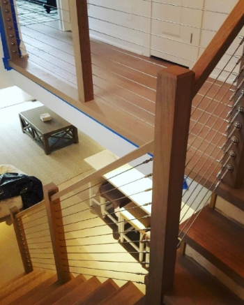 We capped these stairs with white oak tread caps and installed this stainless steel cable railing system. The posts are 3-1/2 contemporary white oak & the railing is a custom square profile in white oak as well.  Job Location: Blue Mountain, ON