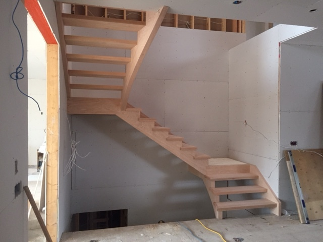 """Open Rise, 2-1/8"""" solid oak treads, flared upper and lower stringers, self support built in landings. Job Location: Toronto, ON"""
