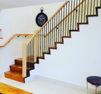 3-1/2 contemporary oak posts, standard oak railing, TL12-40 wrinkled black spindles.  Job Location: Barrie, ON