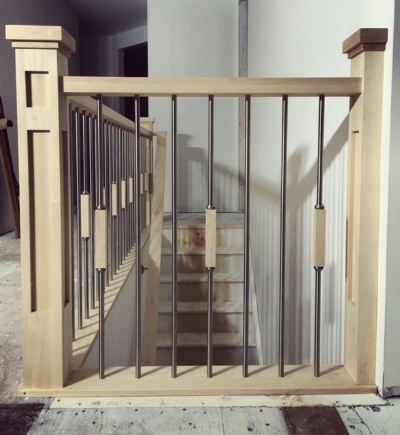 """4-1/2 double square shaker maple posts, contemporary square maple railing, TL58-SS Stainless steel spindles with 7"""" maple square decorative blocks. Job Location: Midhurst, ON"""