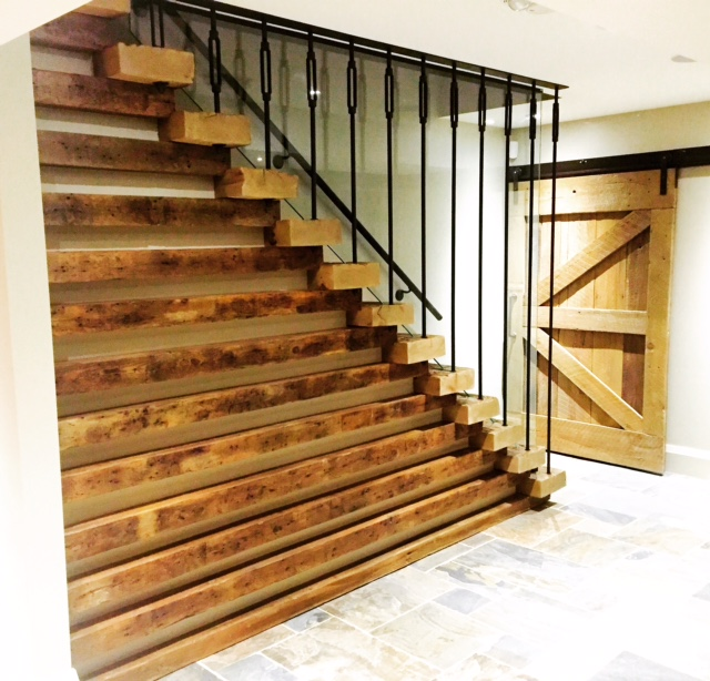 """4"""" barn beam skins for treads, 4"""" wind braces for risers and horizontal accents, custom fabricated/painted turnbuckles with vertical threaded rod, 12mm one piece triangular clear tempered glass.  Job Location: Blue Mountain, ON"""
