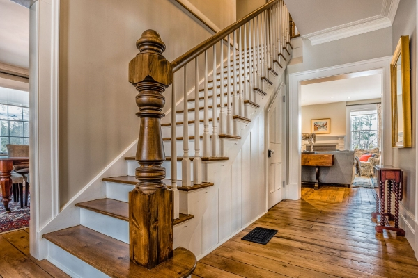 """7-1/2"""" custom turned greeting post, 3-1/2 custom volute post, 1-3/4 custom dowel top paint grade spindles, custom pine railing. We had the existing century old newel post recreated by our pals @adwoodturning with matching custom volute posts. The entire railing is an """"over-the-top"""" system with custom made handrail parts. The pine stairs with victorian gingerbread accents were supplied & installed by Stairhaus as well. Job location: Collingwood, ON. Photography: Martin Jureit  #stairhaus   #stairs   #railings   #barrie   #collingwood   #victorian   #paintgrade   #classic   #colonial   #woodturning   #photography"""