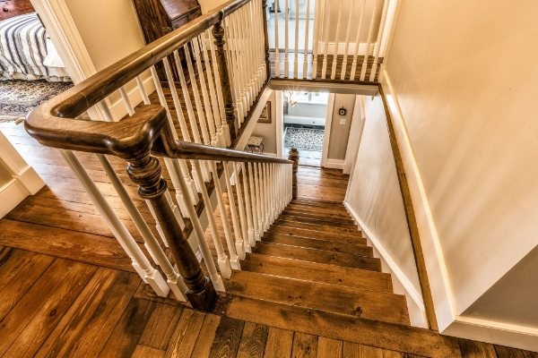 """7-1/2"""" custom turned greeting post, 3-1/2 custom volute post, 1-3/4 custom dowel top paint grade spindles, custom pine railing. We had the existing century old newel post recreated by our pals @adwoodturning with matching custom volute posts. The entire railing is an """"over-the-top"""" system with custom made handrail parts. The pine stairs with victorian gingerbread accents were supplied & installed by Stairhaus as well. Job location: Collingwood, ON. Photography: Martin Jureit"""