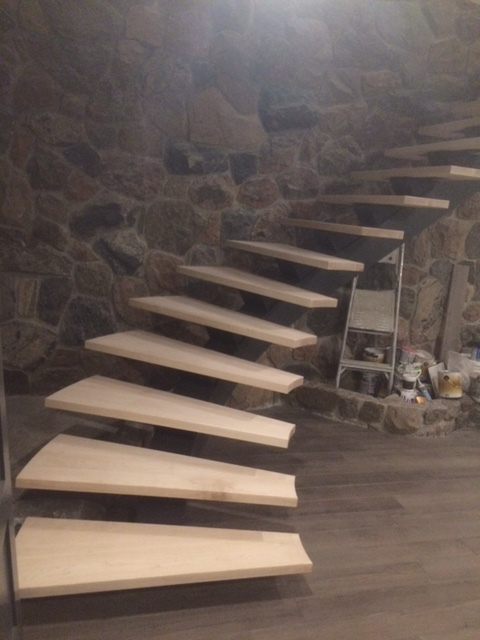 We rebuilt the 1-3/4 maple treads for the steel stringer mono-stringer.  Job Location: Shanty Bay, ON