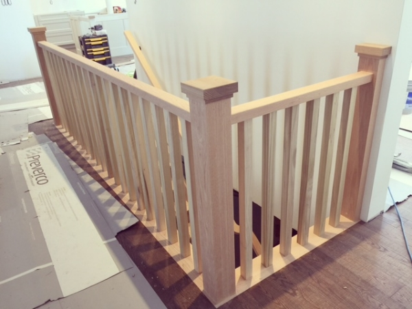 4-1/2 paint grade posts with square custom cap, 1-1/2 x 3 rectangular railing with 1-3/4 poplar spindles.  Job Location: Anten Mills, ON