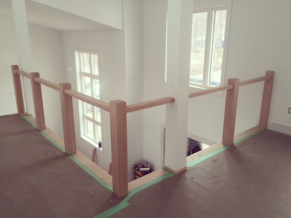 4-1/2 contemporary oak posts, 1-1/2 x 3 contemporary oak flat railing. We will be installing 10mm clear tempered glass with stainless steel clips to this railing frame.  Job Location: Shanty Bay, ON