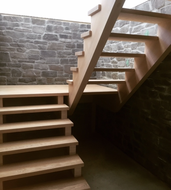 Open rise/open 2 sides red oak stairs with built in self support/floating landing. The landing slab was glued up and supplied by us as well.  Job Location: Blue Mountain, ON