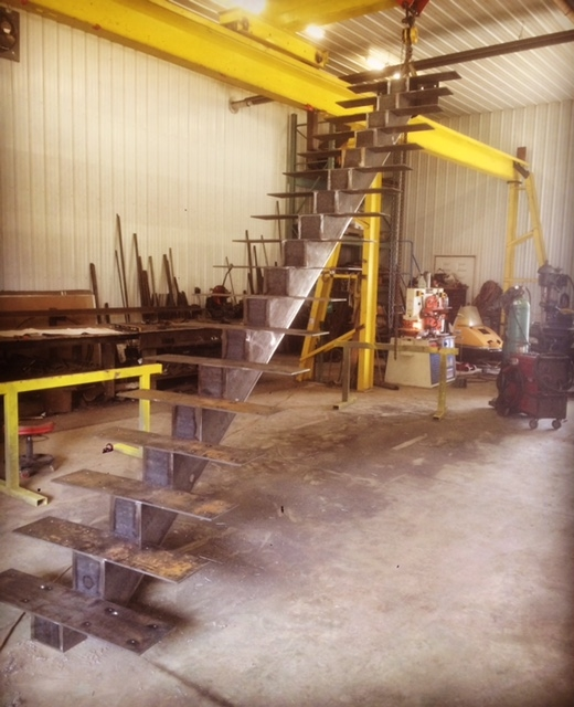 Progress shot: Steel mono stringer with tread plates. This stair will have 1-3/4 maple treads with glass guards.  Job Location: Muskoka, ON