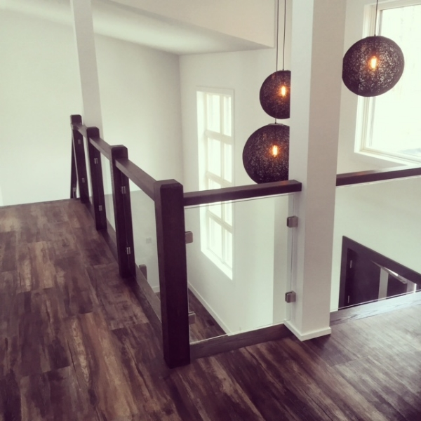 4-1/2 contemporary posts, 1-1/2 x 3 flat oak railing with 10mm stainless steel glass clips & 10mm clear tempered glass.  Job Location: Shanty Bay, ON