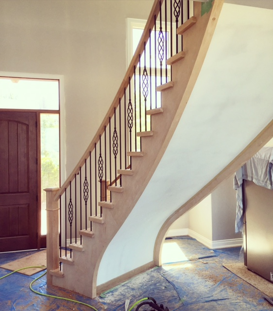 """Open 2 sides hickory stairs with paint grade stringers & risers. 4-1/2"""" fluted posts with caps and TL15RD-40/TL103-1RD-40 wrinkled black spindles.  Job location: Blue Mountain, ON"""