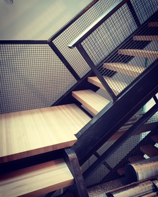 Tubular steel railing with mesh guards, butcher block style side grain treads with solid landing slabs.  Job Location: Toronto, ON