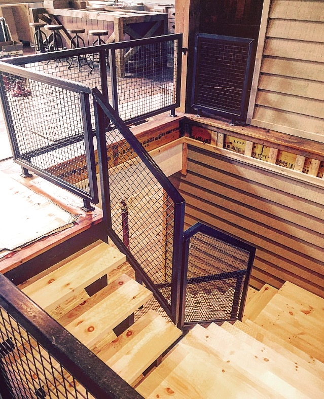 """Tubular steel railing with mesh guards. Stairs are steel/self support with 2-1/8"""" pine treads (solid landing slabs were built too).  Job location: Muskoka, ON"""