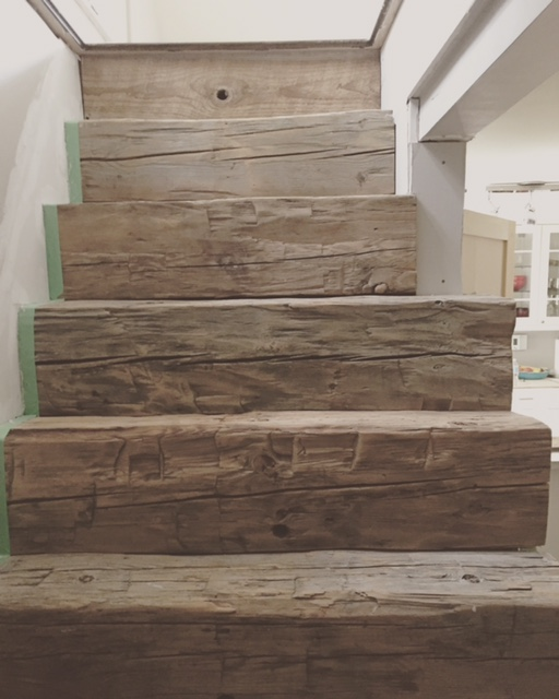 Here is a barn beam stair we built for a century home basement. These beams were provided by the customer and came from a barn off of the property. It was really tricky scribing every rise & run so everything fit together perfectly.    Job location: Orr Lake, ON