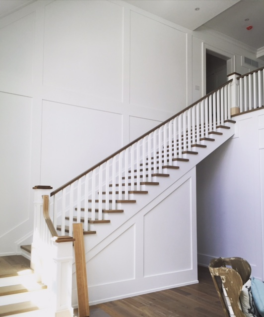 """7-1/2"""" paint grade recessed paneled posts with bases/caps, 1-3/4 x 3"""" white oak railing with 1-3/4"""" paint grade poplar spindles.  Job location: Innisfil, ON"""