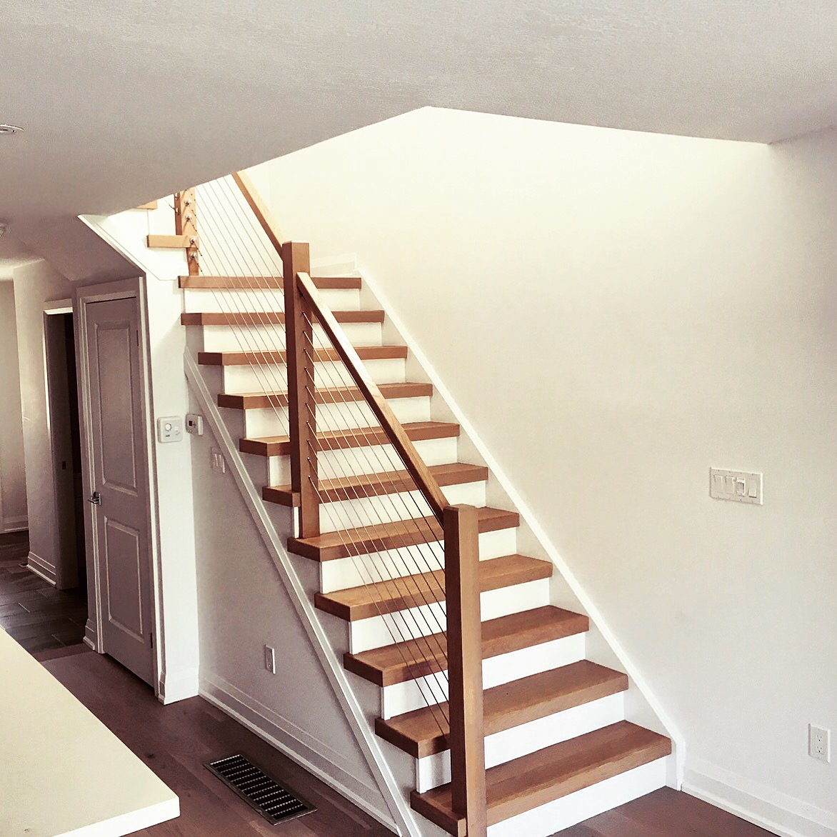 3-1/2 contemporary posts with flat railing, stainless steel cable railing system.  Job location: Collingwood, ON