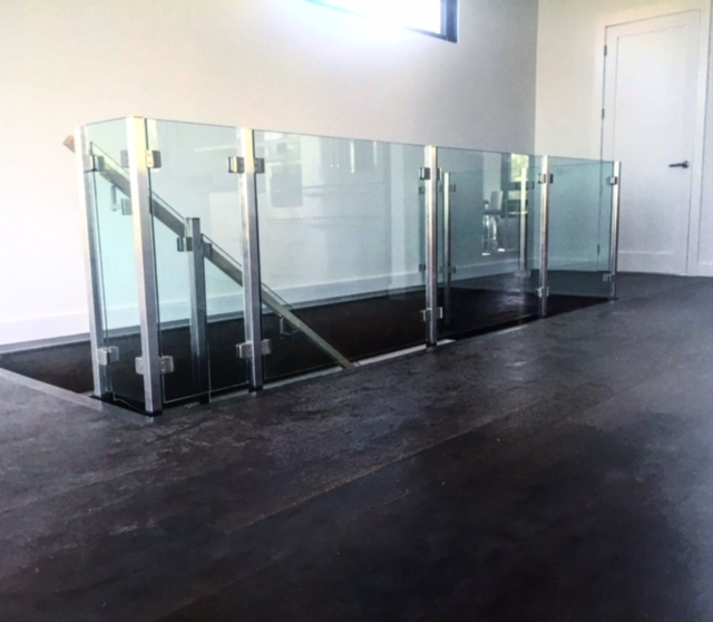 Squareline stainless steel fascia mounted posts with 10mm stainless glass clips. Supplied & installed by Stairhuas.  Job location: Blue Mountain, ON