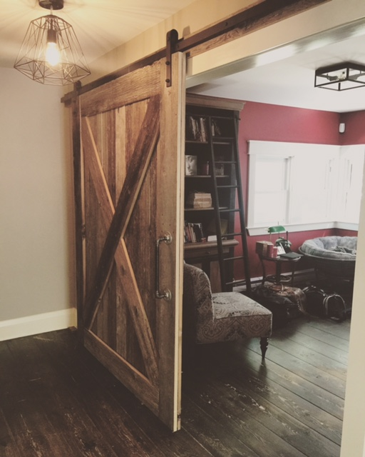 Cross style barn door built by Stairhaus.  Job location: Orr Lake, ON