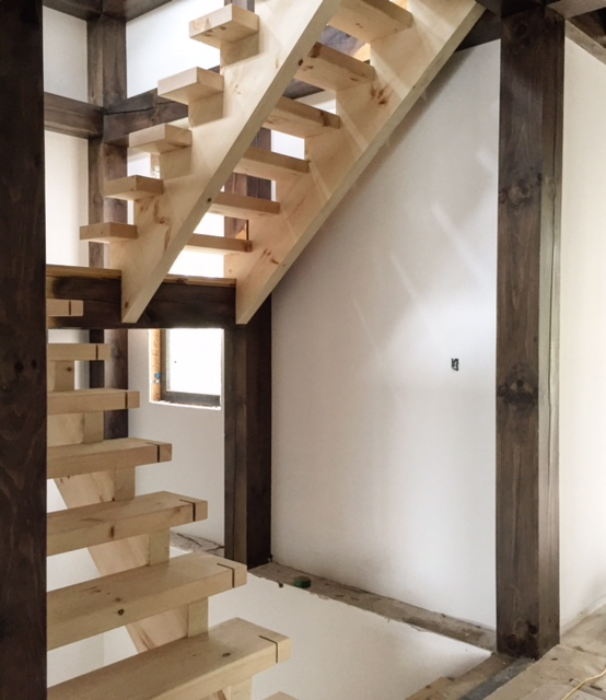 Open 2 sides, open rise - pine stairs. We used 2-3/4 solid treads which have an angled dado to accept glass.  Job location: Innisfil, ON
