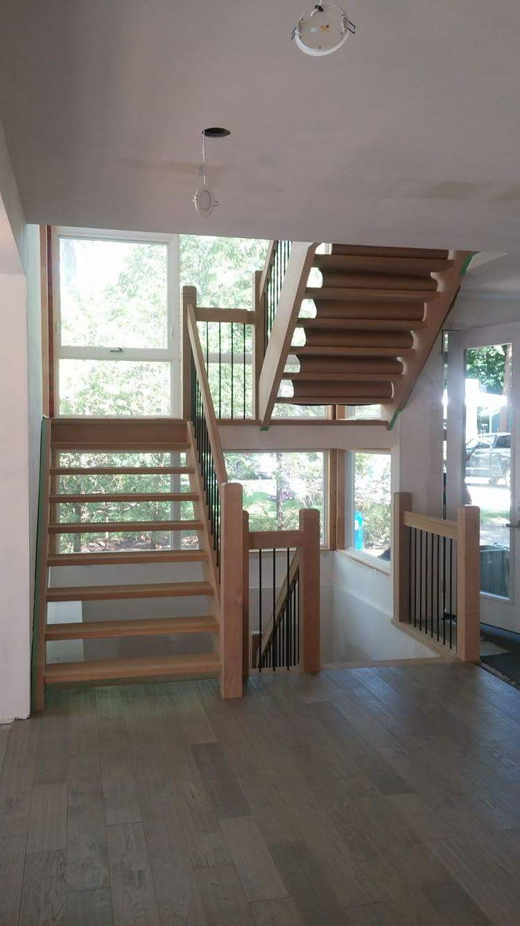 Stairs and railings supplied & installed by Stairhaus. Closed 2 sides white oak stairs with 4-1/2 double dado contemporary posts, 1-3/4 x 4-1/2 vertical single dado railing with plain TL15-40 round spindles.  Job location: Innisfil, ON