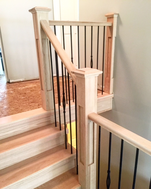 Out with the old, in with the new! We capped 2 sets of stairs in the house with our solid oak, custom made, tread caps. Our standard oak railing, 4-1/2 oak shaker posts and TL15-40/TL102-1RD-40 wrinkled black spindles. Job location: Barrie, ON.