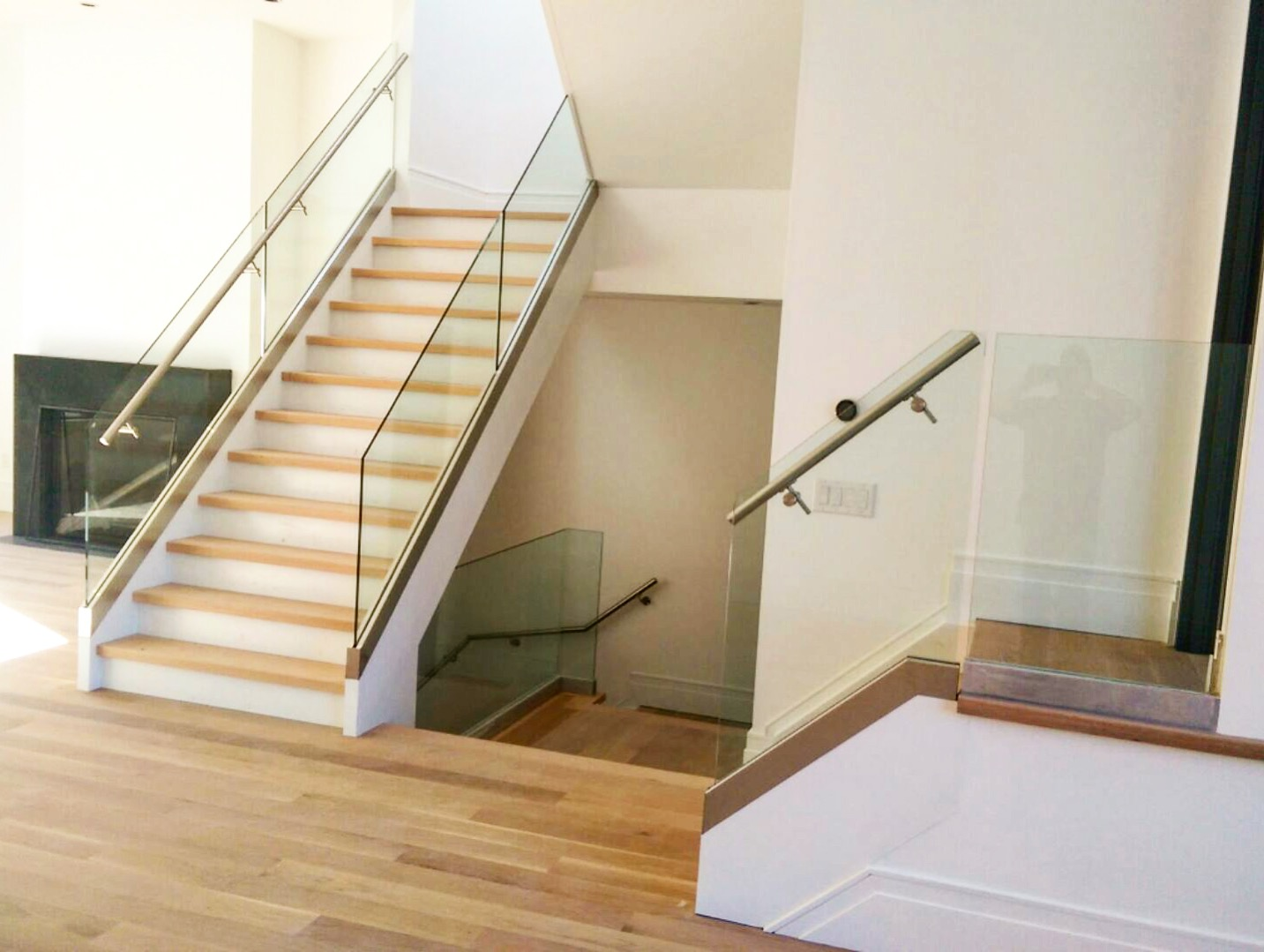 Toronto contemporary at its finest. Our friends @purebuildinggroup knocked these mirrored contemporary semi-detached residences out of the park! We supplied the stairs - 10 sets per unit! The stairs were closed 2 sides, paint grade stringers with 1-3/4 white oak treads. Hats off to Global Aluminum Solutions for a killer railing/glass job.  Job location: Toronto, ON.
