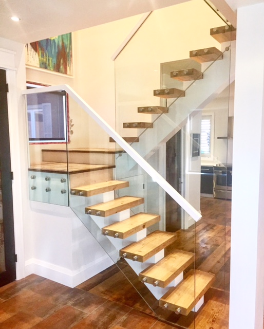 """his stair has a wood mono-stringer with 2-3/4"""" reclaimed hemlock treads. We used 12mm clear tempered glass with 1-1/2"""" stainless steel standoff's.  Job location: Barrie, ON."""