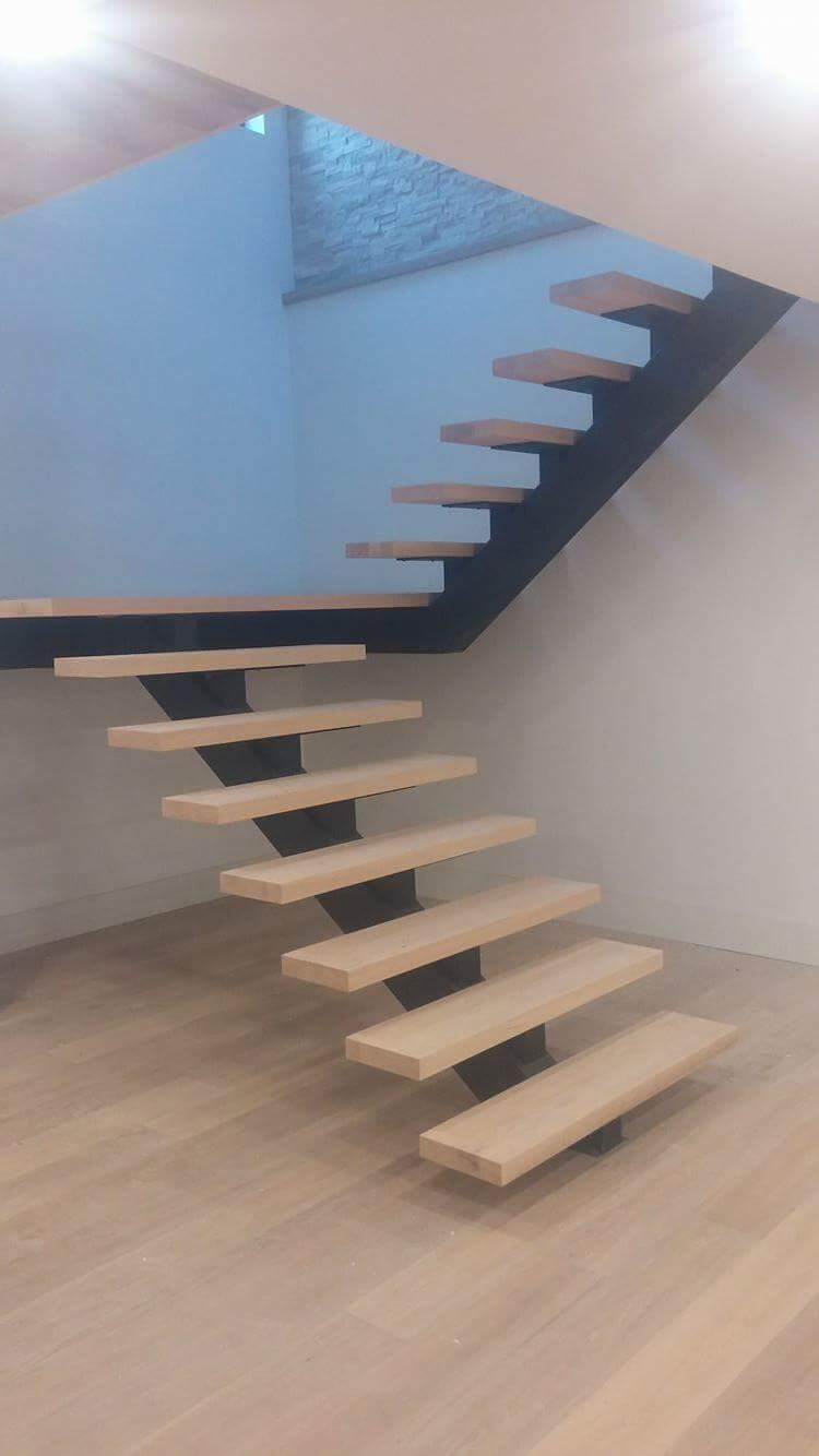 """Treads and landing slabs installed. We used 2-1/4"""" oak to dress these steel self support mono-stringers. These stairs will be getting the stand-off glass treatment.  Job location: Shanty Bay, ON."""