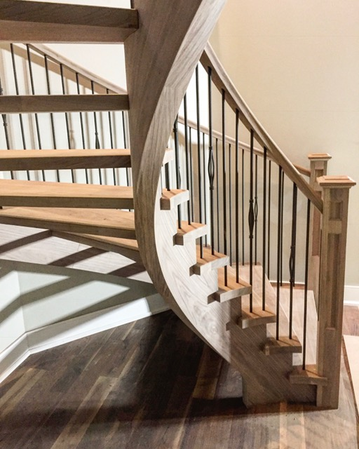 Open 2 sides, open rise circular was dressed up with our standard rail, 4-1/2 double square shaker posts with TL15-40 & TL102-1RD-40 wrinkled black spindles. Walnut rules!  Job location: Essa, ON.