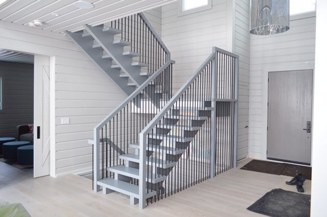 """Stairs & railings supplied and installed by Stairhaus. Amazing finishing work by our #1 finisher @paintorridesthelightning. All 4 sets of stairs are open rise - 2-1/4"""" treads. The main landing is self support (built into stair) and both landings have solid slabs for tops. We had custom steel spindles made which run from the underside of the landing slab/treads to the main floor.  Job location: Tiny Beaches, ON"""