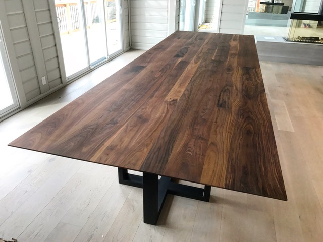 """5x15 Infinity Walnut dinner table with custom steel base. The top alone weighs in around 700lbs - it took 6 of us to carry it into the house. The edge is beveled to give it an infinity look (the slab is 1-3/4"""" solid). Job location: Tiny Beaches, ON"""
