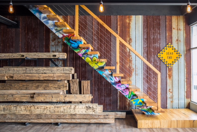 """Stairhaus showroom. Wood mono-stringer with 3"""" reclaimed elm treads.  Job location: Barrie, ON"""