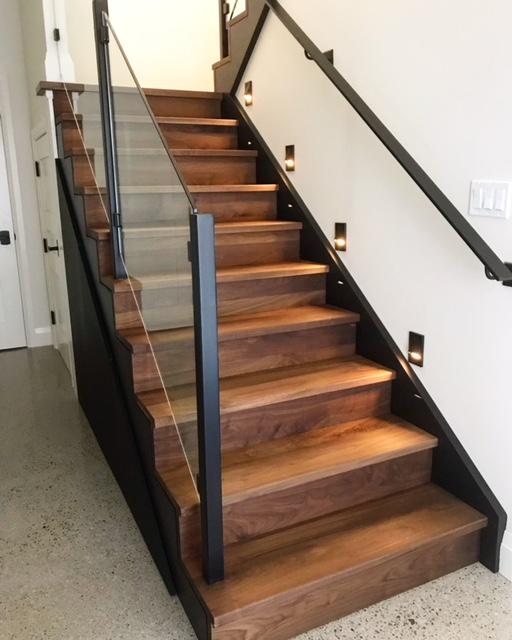 """Infinity walnut stair with custom 1/4"""" walnut reveals on open side.  Job location: Muskoka, ON"""