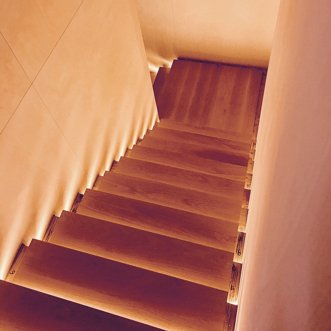 White oak infinity stair with custom light details (hidden channels).  Job location: Blue Mountain, ON
