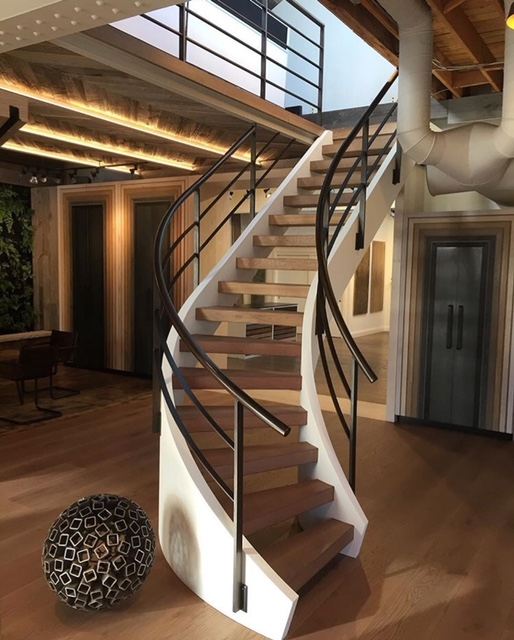 """Closed 2 Sides open rise stair with 4"""" reclaimed box treads and paint grade stringers.  We had a tubular horizontal steel railing system fabricated to finish this off.  Job location: Toronto, ON (Northern Wide Plank's downtown showroom)"""