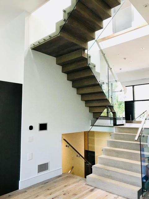"""Steel infinity Z-stair clad in 1-1/16"""" white oak.  Job location: Toronto, ON"""
