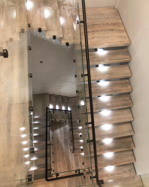 "HSS steel mono-stringer with 2-3/4"" solid red oak treads. We installed hidden LED lighting in the treads/landing slabs.  Job location: Aurora, ON"