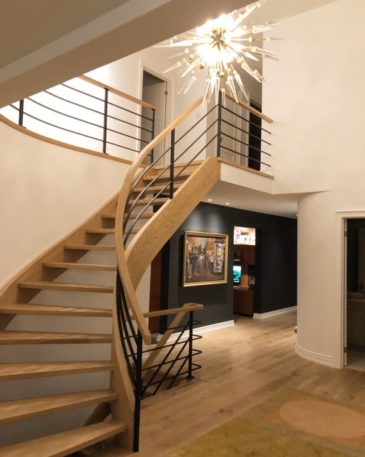 Closed 2 sides/open rise white oak stair with 1-3/4 solid treads.  We had a custom fabricated horizontal railing system installed with a flat white oak cap railing.  Job location: Pickering, ON