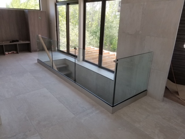 Brushed steel base shoe with 12mm glass.  Job location: Blue Mountain, ON