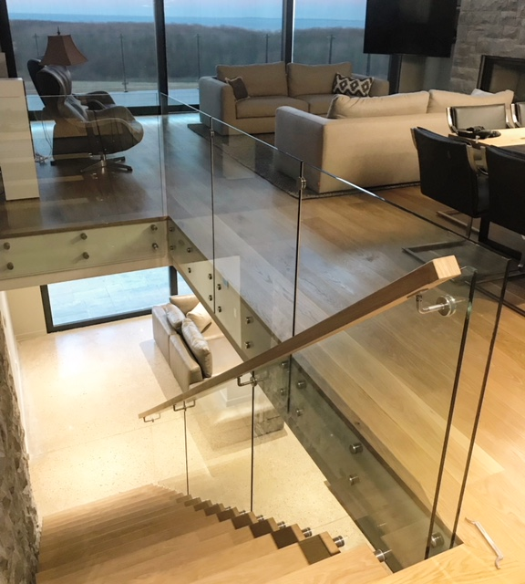 """12mm glass installed using 1-1/2"""" stainless steel standoffs.  Job location: Blue Mountain, ON."""