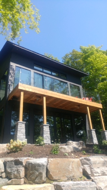 12mm clear tempered glass with stainless steel square steel posts.  Job location: Muskoka, ON.