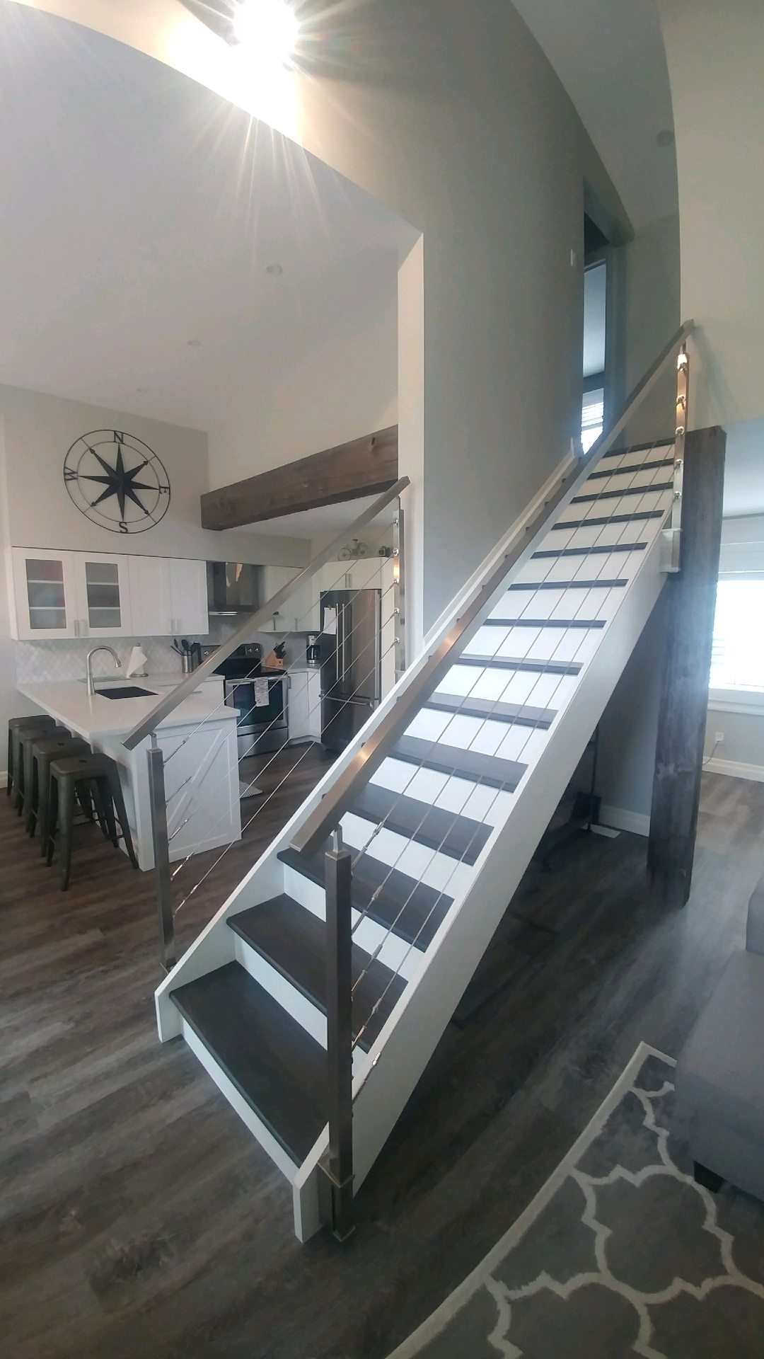Stainless steel square posts/railing with cable railing (does not pass code).  Job location: Collingwood, ON.